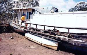 Eric Reye on his boat 'Coolooloa' at Rusters boatyard in the early 1990s