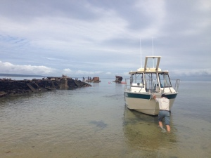 'Limosa' at Platypus Bay, Peel Island. Stone jetty left and 'Platypus' hulk in rear of photo.