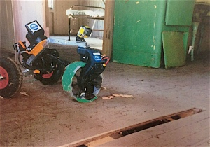 The three wheeled robot with GoPro cameras front and back