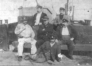Tom Welsby (centre) and fishing crew