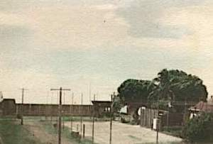 An early colorised print of the Lazaret tennis court. Recreation Hall behind (photo courtesy Rosemary Opala)