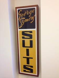 Copy of the sign that graced George Symons Suit factory in Elizabeth Street, Brisbane